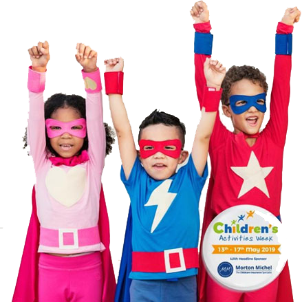 children dressed as superheroes raising their arms